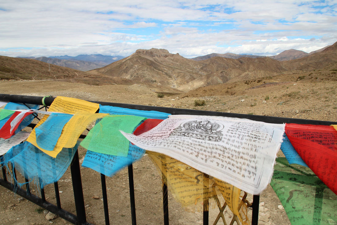 The Lung-ta (prayer flag) allowed the prayers to be spread by the wind. The color of the flags symbolized the five basic elements-namely, wind, water, fire, earth and wood in Tibet, China Close-up Cloud - Sky Colourful Day Flag Hanging Mountain Multi Colored Nature No People Outdoors Scenics Sky Tibetan Prayer Flags
