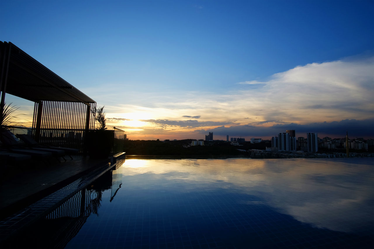 sunset, sky, water, built structure, architecture, building exterior, outdoors, silhouette, waterfront, no people, nature, cloud - sky, skyscraper, city, beauty in nature, scenics, cityscape, day