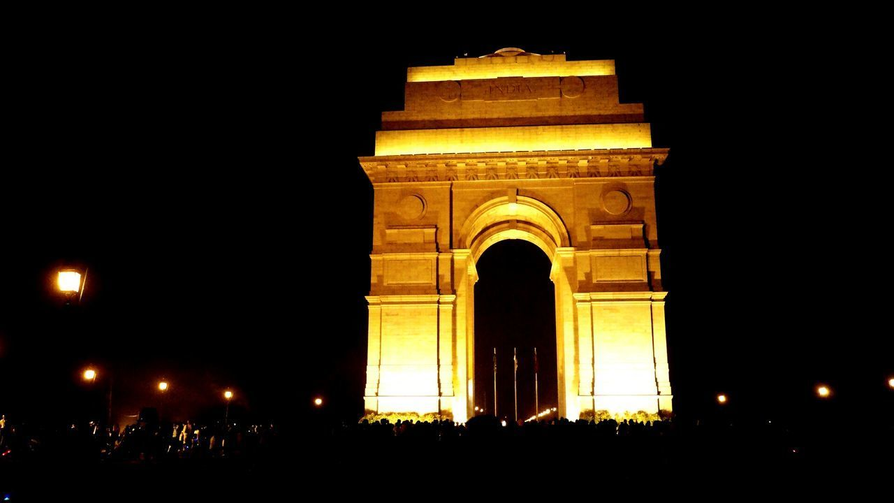 architecture, arch, built structure, illuminated, night, history, triumphal arch, building exterior, low angle view, travel destinations, outdoors, sky, city, no people