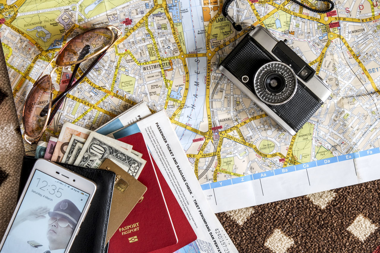 Top view of travel documents, map, cash, credit card, camera and mobile device Airline Camera Cash Credit Card Document Horizontal Map Mobile Phone Money Natural Light No People Passport Smartphone Tickets Top View Travel Travel Essentials Travel Items Let's Go. Together.