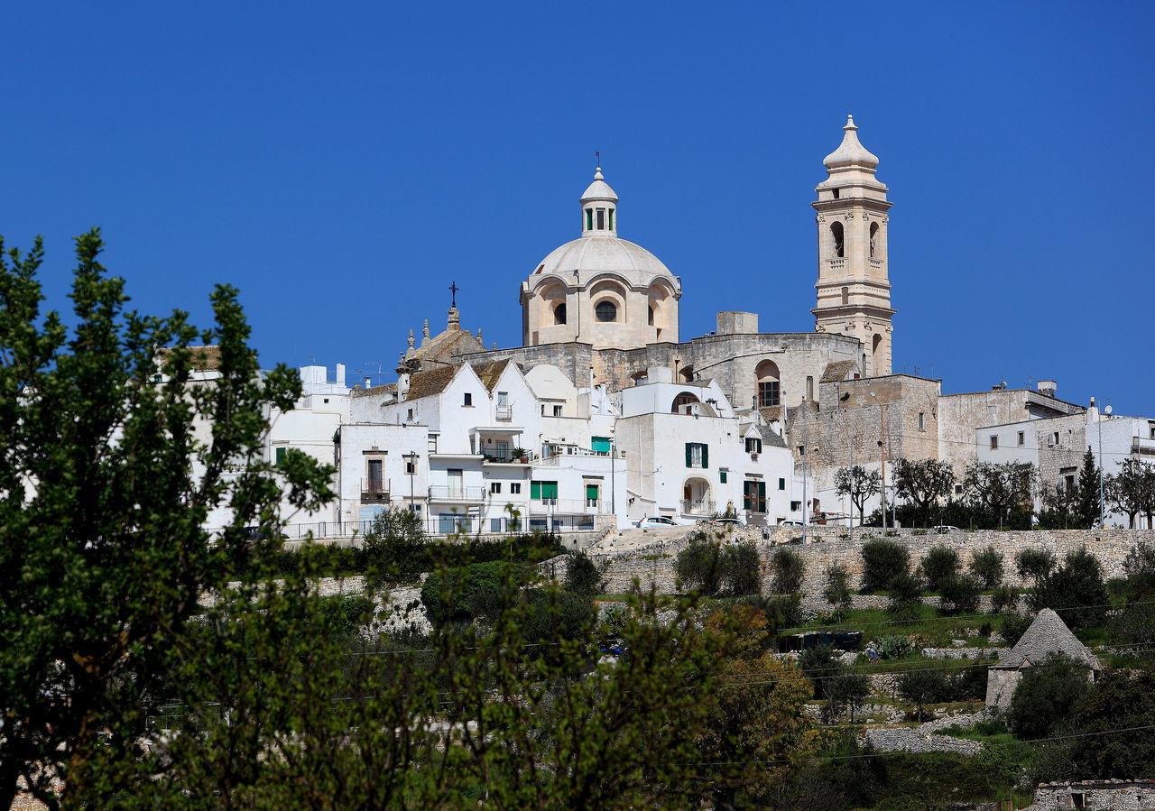 Skyline of Locorotondo, Puglia, Italy Architecture Blue Building Exterior Built Structure Clear Sky Cultures Day Italy Landscape Locorotondo No People Outdoors Pilgrimage Place Of Worship Puglia Religion Sky Travel Destinations Tree