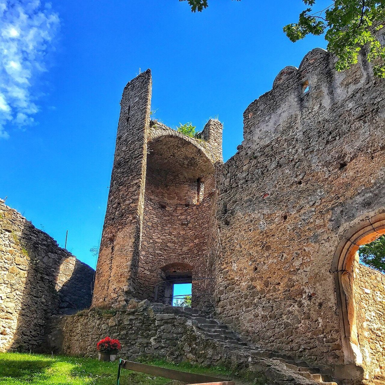 architecture, history, built structure, the past, building exterior, day, low angle view, old ruin, ancient, travel destinations, travel, real people, outdoors, ancient civilization, castle, men, one person, women, clear sky, sky, nature, people