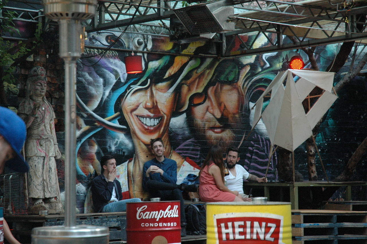 Embrace Urban Life Enjoy The New Normal Chance Encounters Indoors  Smiling Chilling Out Friends Togetherness Graffiti Graffito Happy Hour Hideout Streetphotography Street View Booze Camp Out Eyeemphoto The Street Photographer - 2017 EyeEm Awards