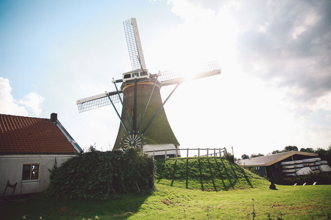 Alternative Energy Autumn Back Lit Countryside Day Environment Environmental Conservation Equipment Fuel And Power Generation Grass Growth Motorbike Nature Netherlands No People On The Road Outdoors Renewable Energy Sky Trip Wind Power Wind Turbine Windmill