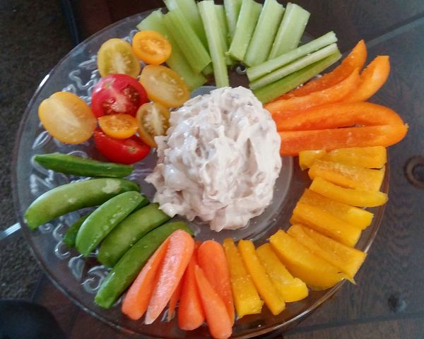 Celery, orange and yellow bell pepper, carrots, snow peas, baby heirloom tomatoes and homemade French onion Greek yogurt dip!....healthy AND satisfying!