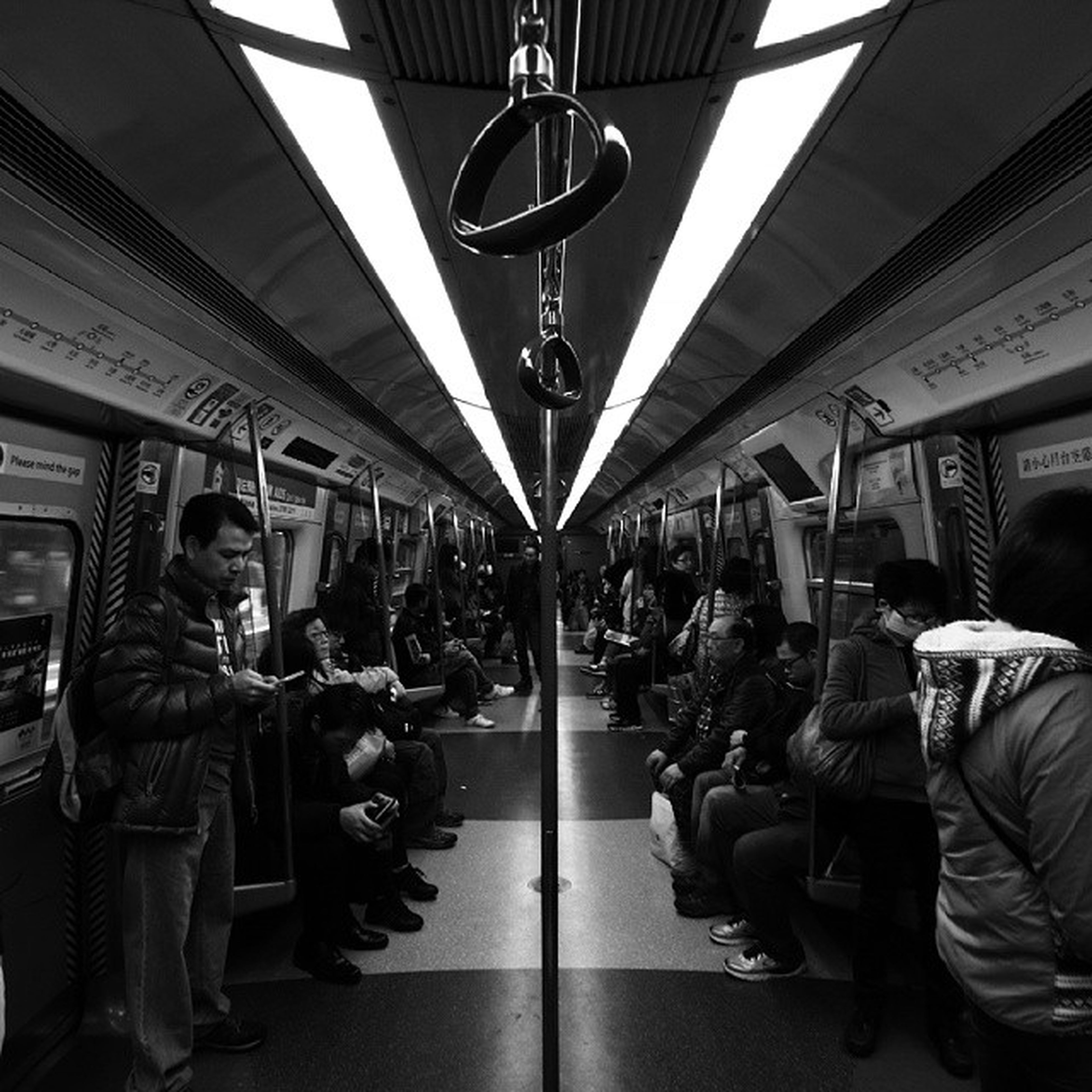 men, lifestyles, indoors, person, leisure activity, large group of people, transportation, medium group of people, public transportation, city life, retail, shopping, casual clothing, passenger, standing, walking, mode of transport, architecture