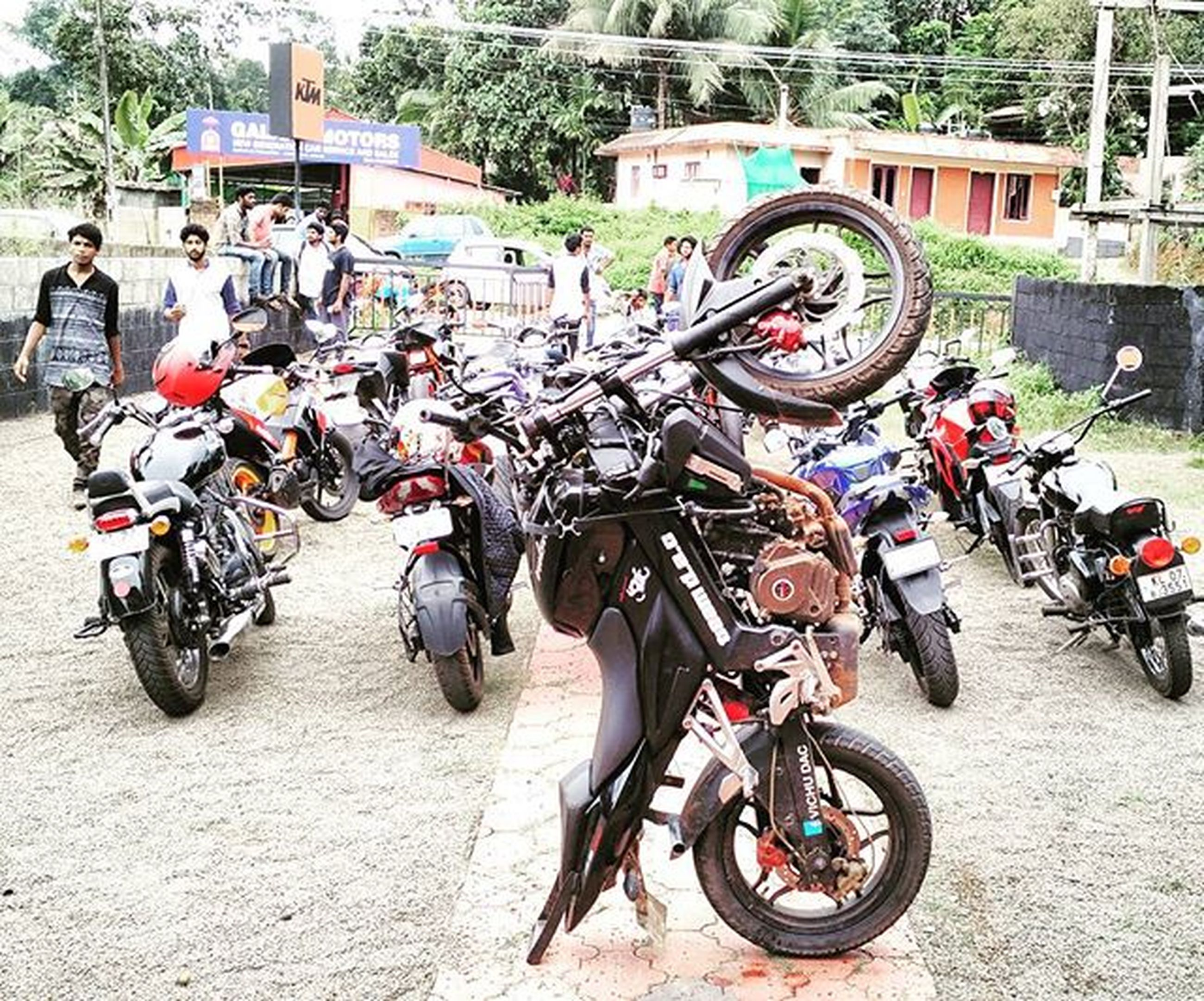 bicycle, transportation, mode of transport, land vehicle, stationary, parking, parked, men, large group of people, street, motorcycle, travel, riding, person, road, day, lifestyles, parking lot, mixed age range