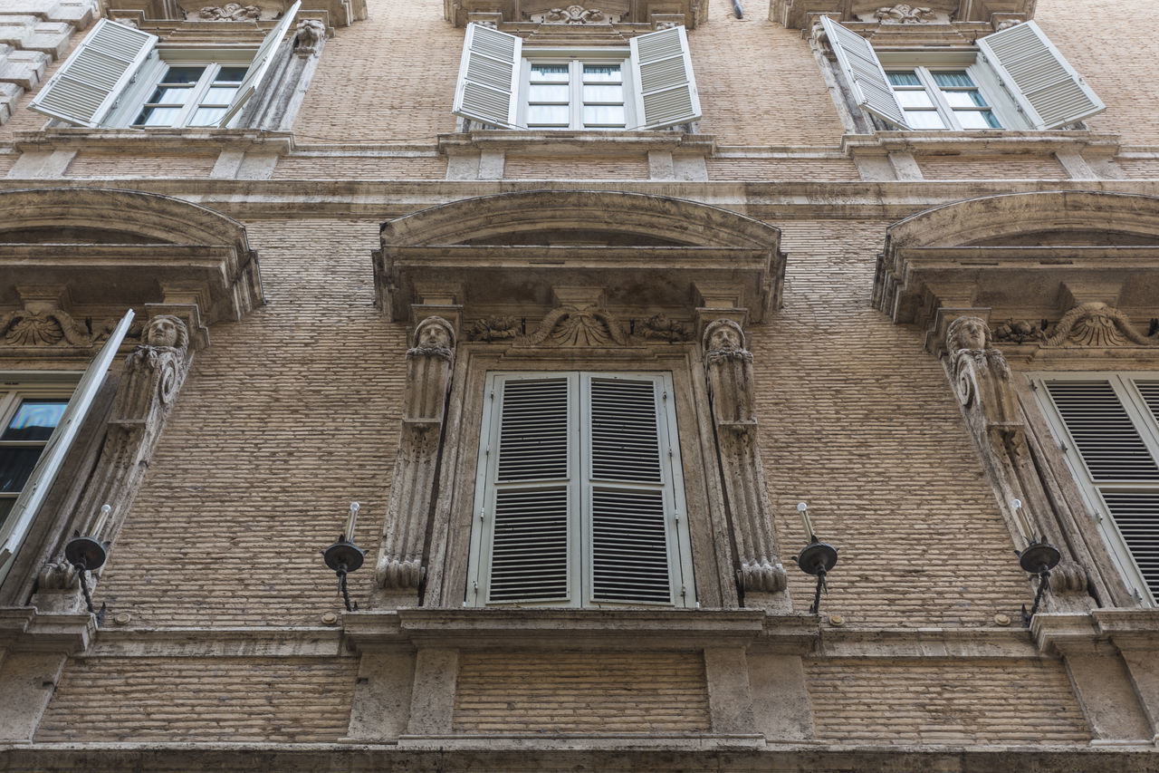 Ornate roman windows with shutters, Rome, Italy Architecture Artistic Beautiful Building City Decorated Decoration Decorative Destination Detail Europe European  Exterior Façade Historic History House Italian Italy Mediterranean  Old Ornament Ornamental Ornamented Ornate