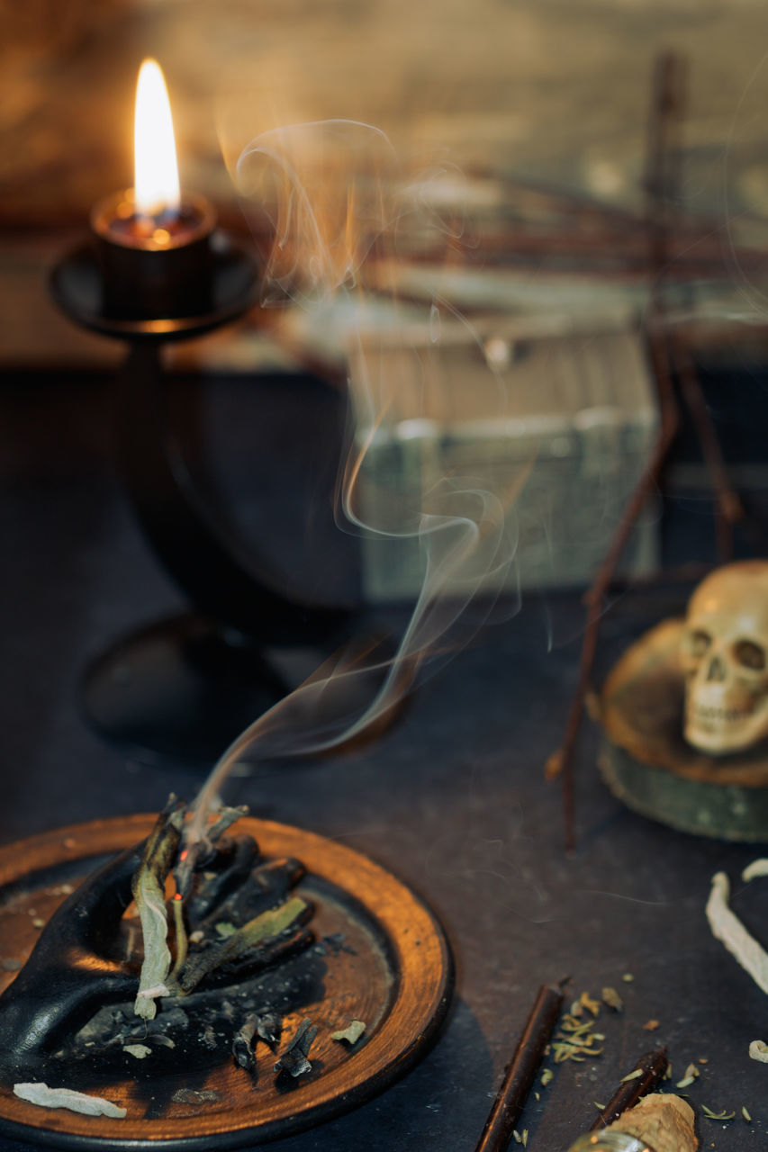 Smoke Emitting From Of Twig By Human Skull During Halloween