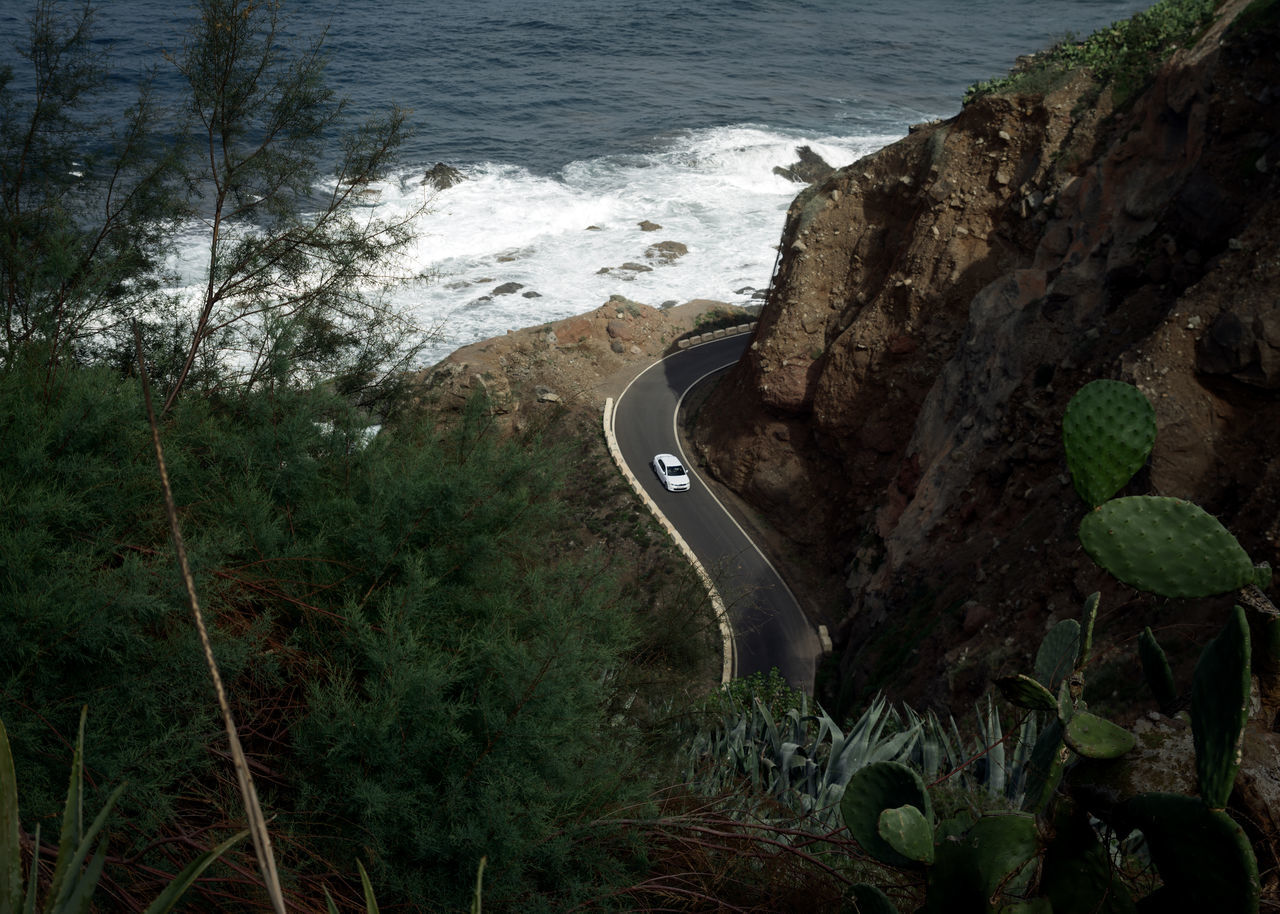 Driving at the Speed Limit Brown Bushes Green Horizons Linas Was Here Panorama Road Rocks Seaside Shore Tenerife Waves White Car