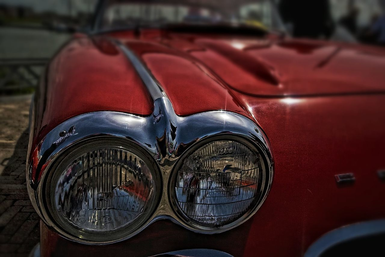 mode of transport, car, land vehicle, transportation, headlight, red, outdoors, old-fashioned, reflection, day, retro styled, close-up, no people