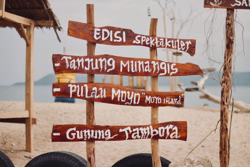 """""""Top destinations"""" Text Western Script Communication Warning Sign Day Outdoors Safety Beach No People Sea Close-up Water Nature Sky Moyoisland"""