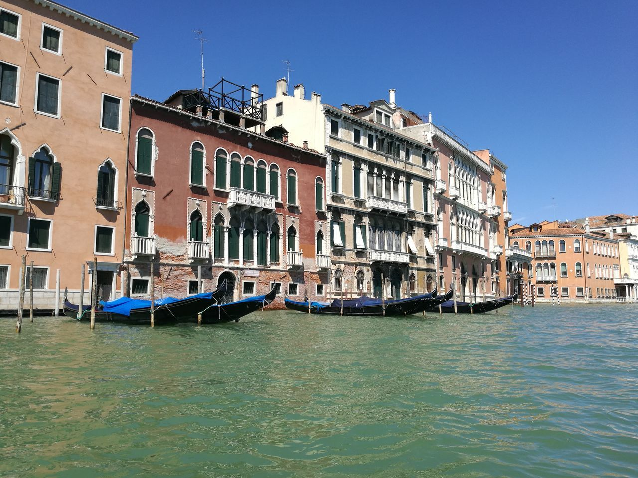 architecture, building exterior, canal, transportation, nautical vessel, water, clear sky, gondola - traditional boat, outdoors, built structure, day, no people, city