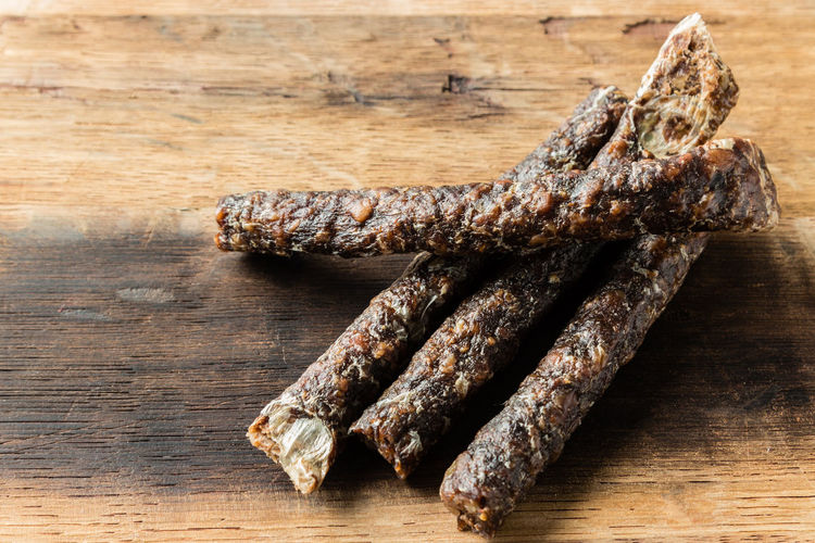 Droewors (biltong) on a wooden board Droe Wors Rustic Snack South Africa Wooden Table Artisinal Biltong Close-up Cultures Cured Meat Cutting Board Delicious Dried Meat Droewors Food Food And Drink Meat No People Protein Snack Salty Tasty Wood - Material
