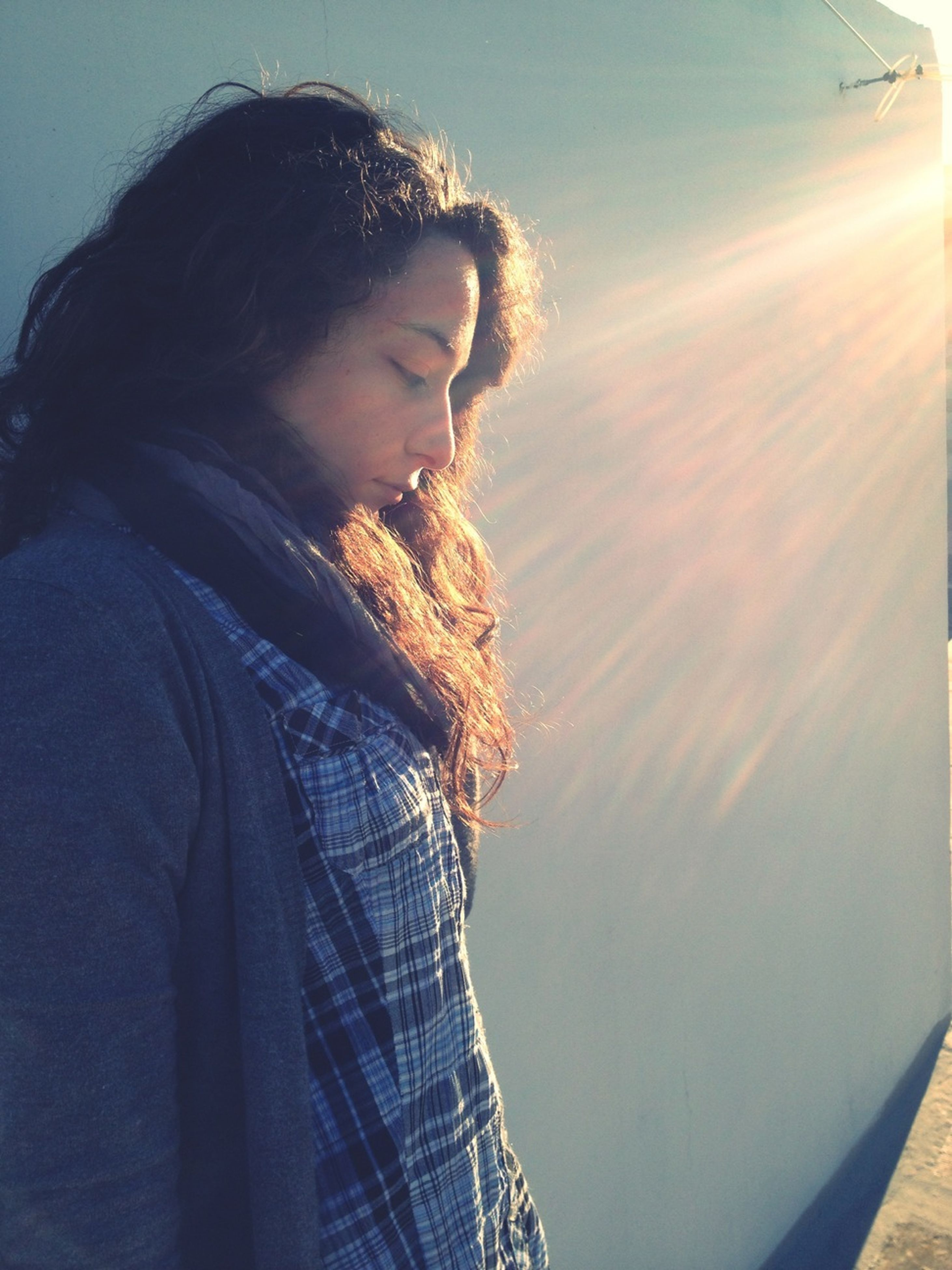 lifestyles, young adult, leisure activity, casual clothing, person, young women, sun, sunlight, sunbeam, long hair, headshot, three quarter length, standing, waist up, contemplation, side view, looking away, lens flare