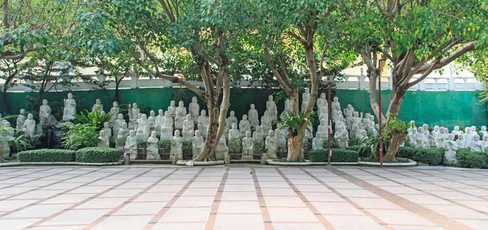 Kaohsiung, Taiwan - December 15, 2015 : Hand carved Buddha at the entrance of Fo Guang Shan. ASIA Asian  Asian Culture Beauty In Nature Buddha Buddha Statue Day Fo Guang Shan Green Color Growth Kaohsiung Nature No People Outdoors Plant Religion Summer Taiwan Tradition Tranquility