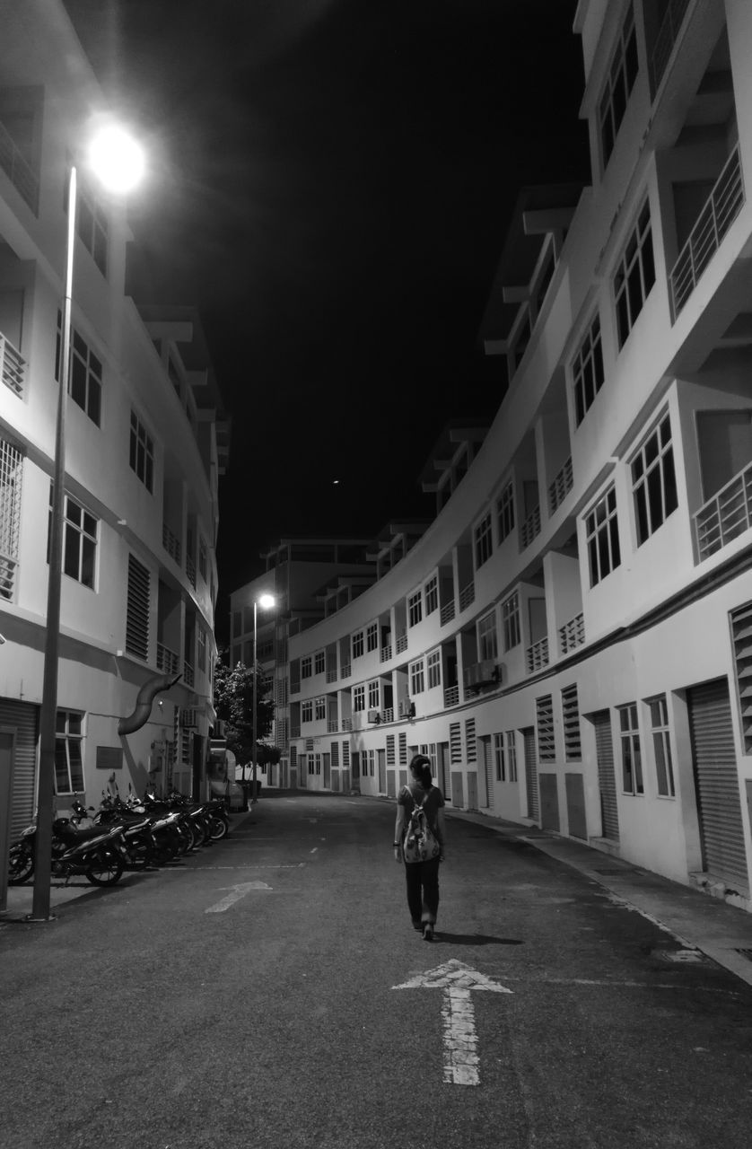 architecture, building exterior, built structure, rear view, night, street, one person, real people, outdoors, city, full length, illuminated, men, sky, people