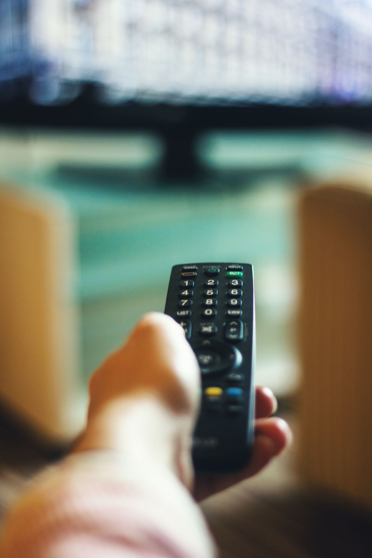 Remote control Choice Close-up Control Day Device Screen Digital Display Hilton Hotel Holding Human Body Part Human Hand Indoors  Leisure Activity Liquid-crystal Display One Person People Push Button Real People Remote Control Technology Television Set Television Show Watching Tv