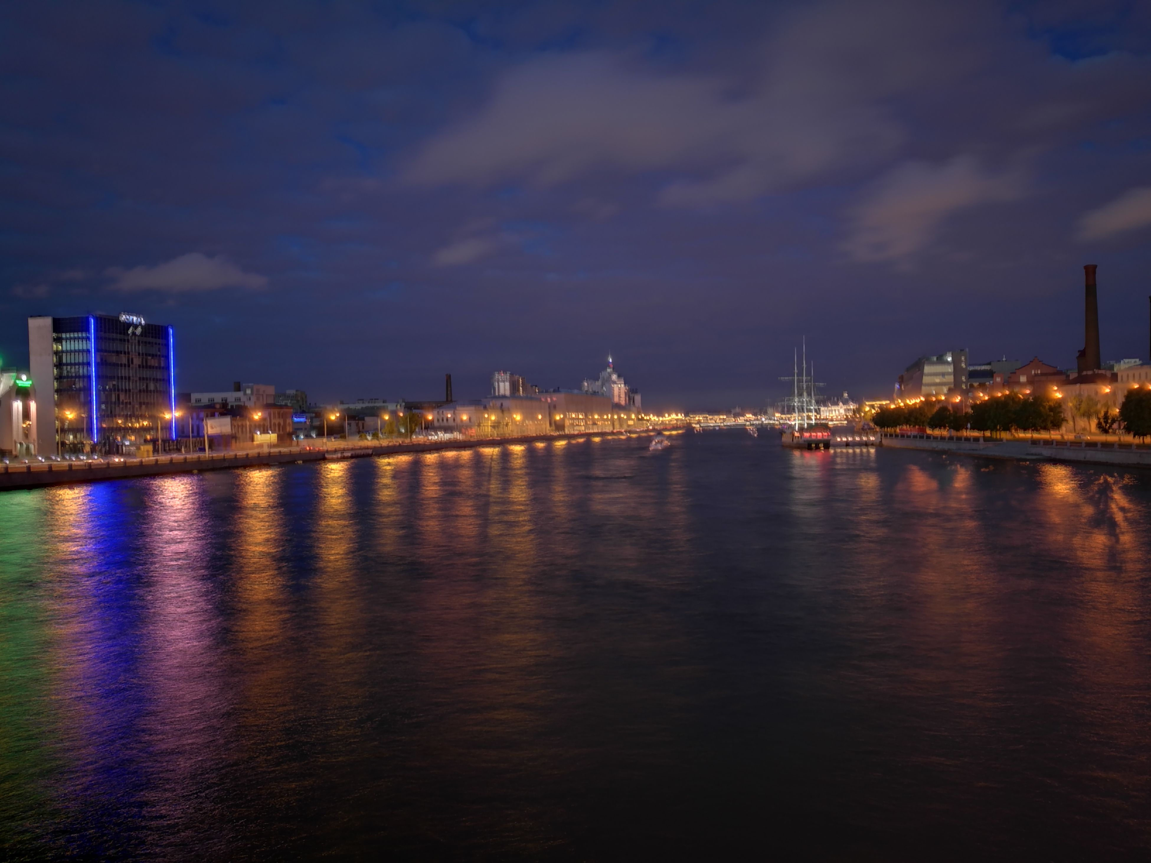 architecture, built structure, building exterior, illuminated, sky, waterfront, city, water, night, reflection, cloud - sky, travel destinations, river, cityscape, no people, outdoors, skyscraper, urban skyline, nature