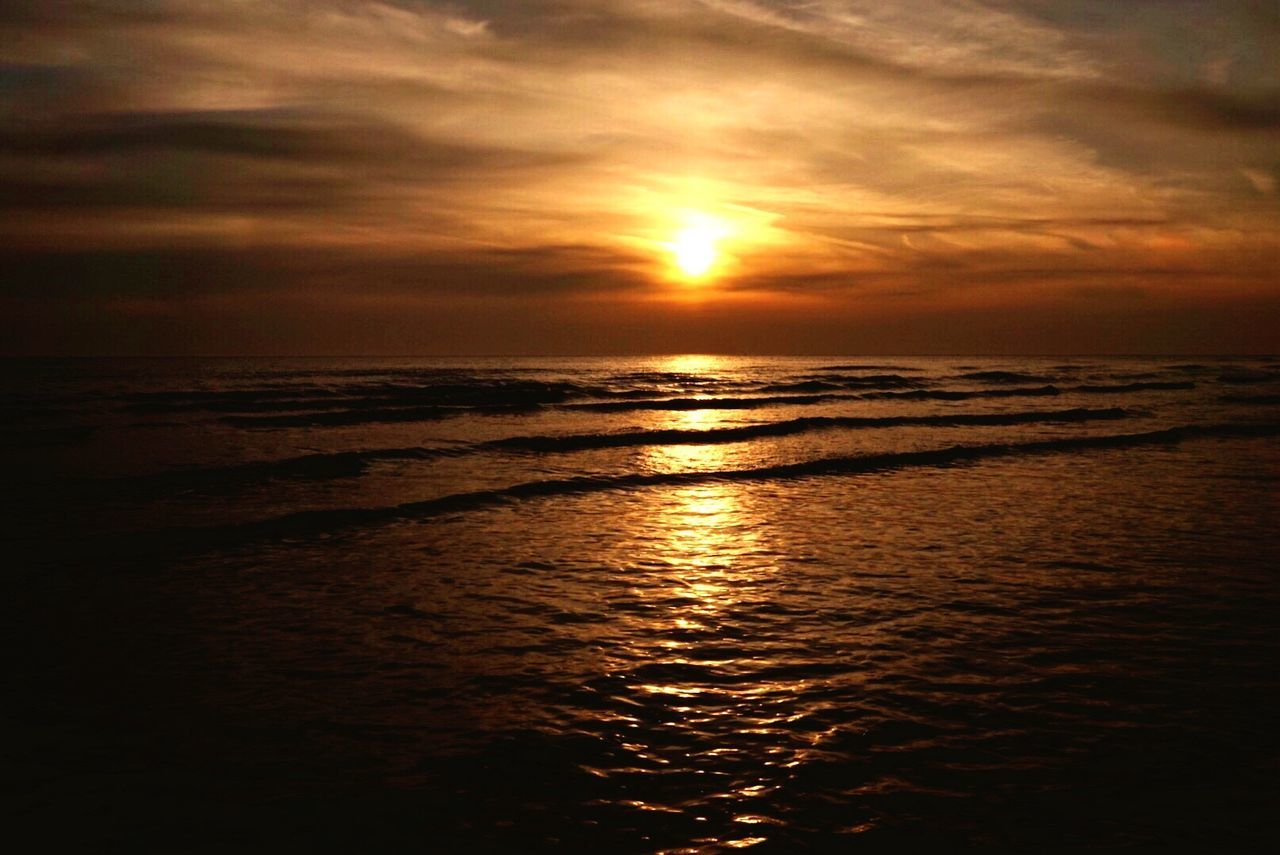 The waves beside them danced..✨💫 See The World Through My Eyes Sunset Sea Sun Reflection 8wa Bluewinged Angel Nature Beauty In Nature No People Outdoors Somewhere Only We Know