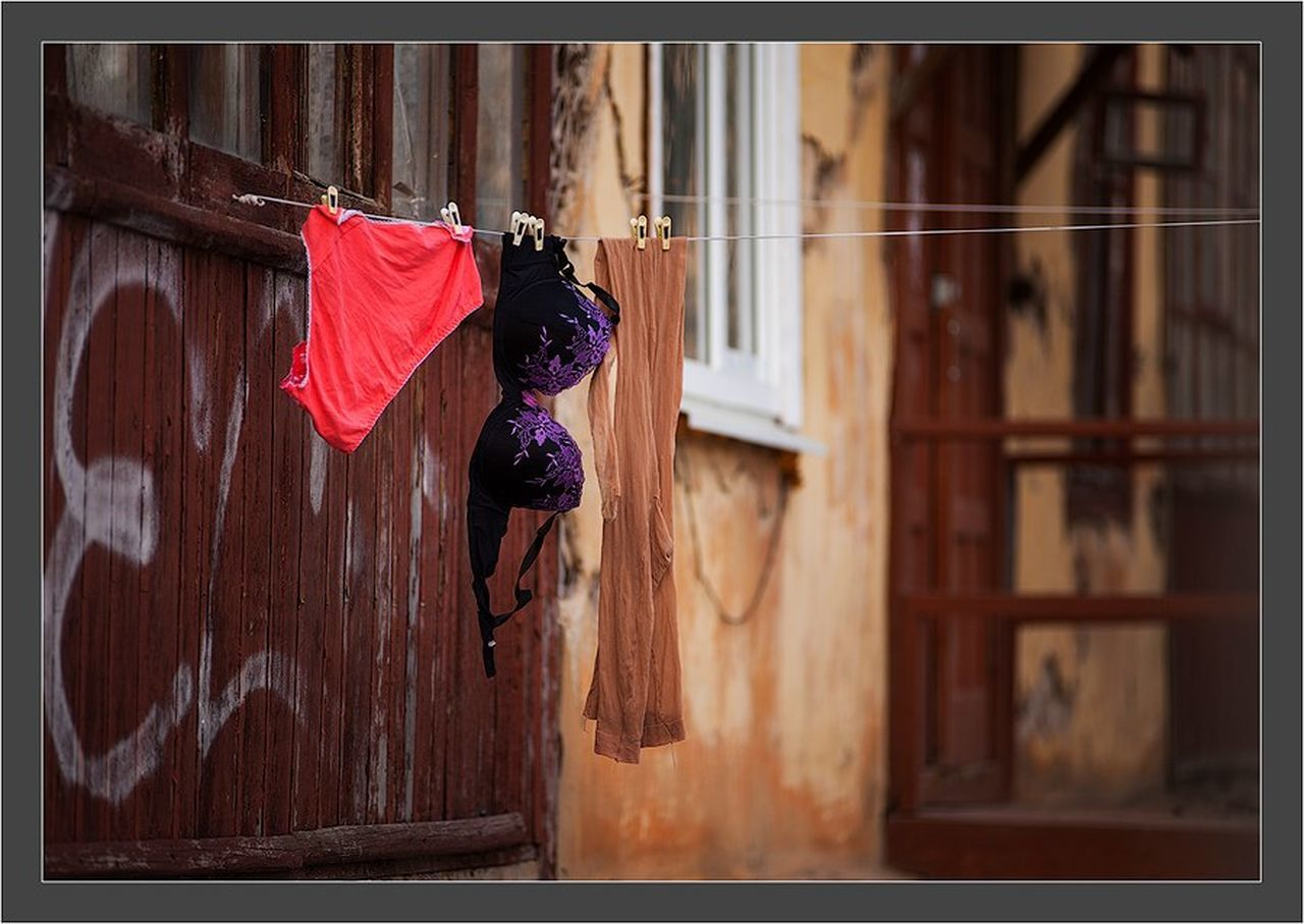 Still Life StillLifePhotography Street Photography Streetphotography City Life City Spring Is Coming  Spring Has Arrived Spring Is Coming  Spring Day Outdoors Architecture Wall Building Exterior Laundry Outside Façade Red Color Window Clothing Canon EF 100-400 L IS USM Canon 5d Mark ıı