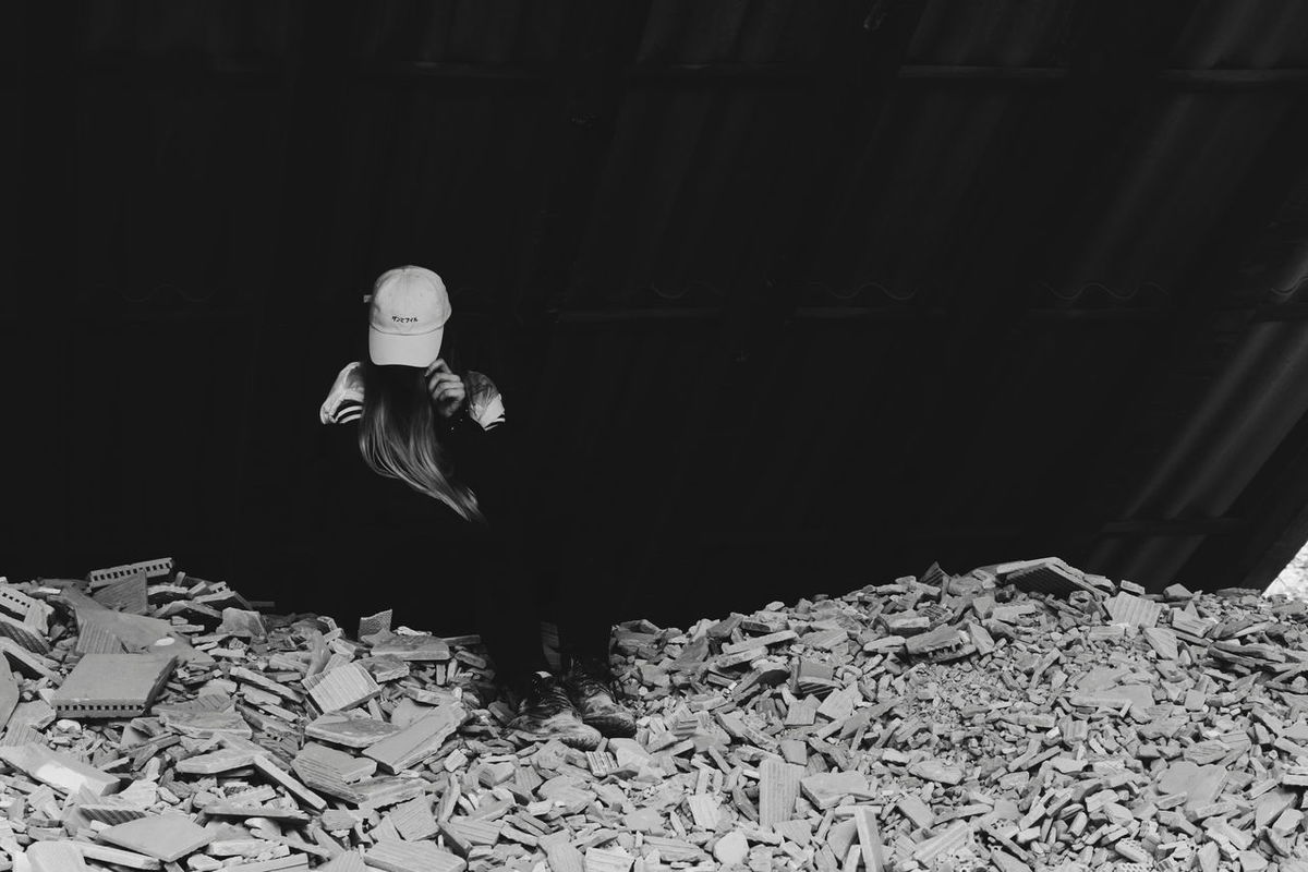 One Person Freedoom  Happiness Summer Summer Happiness One Woman Only Lifestyles Standing Young Adult Destroyed Building Young Women Architecture Black And White Blackandwhite One Young Woman Only Only Women Women Built Structure Long Hair Human Hair Outdoors Day Adult Baseball Cap Cap