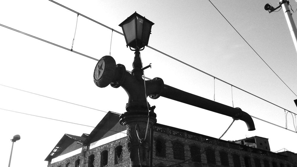 Low Angle View Outdoors Architecture_bw Wires And Sky Objects And Subjects Film Electricity  Forms And Shapes Urban Exploration Windows_aroundtheworld Monochrome Popular Photos Minimalism_bw Lines And Angles No People Old Abandoned Places Technology Lantern Eye4photography  Welcome To Black Lost In The Landscape The Graphic City