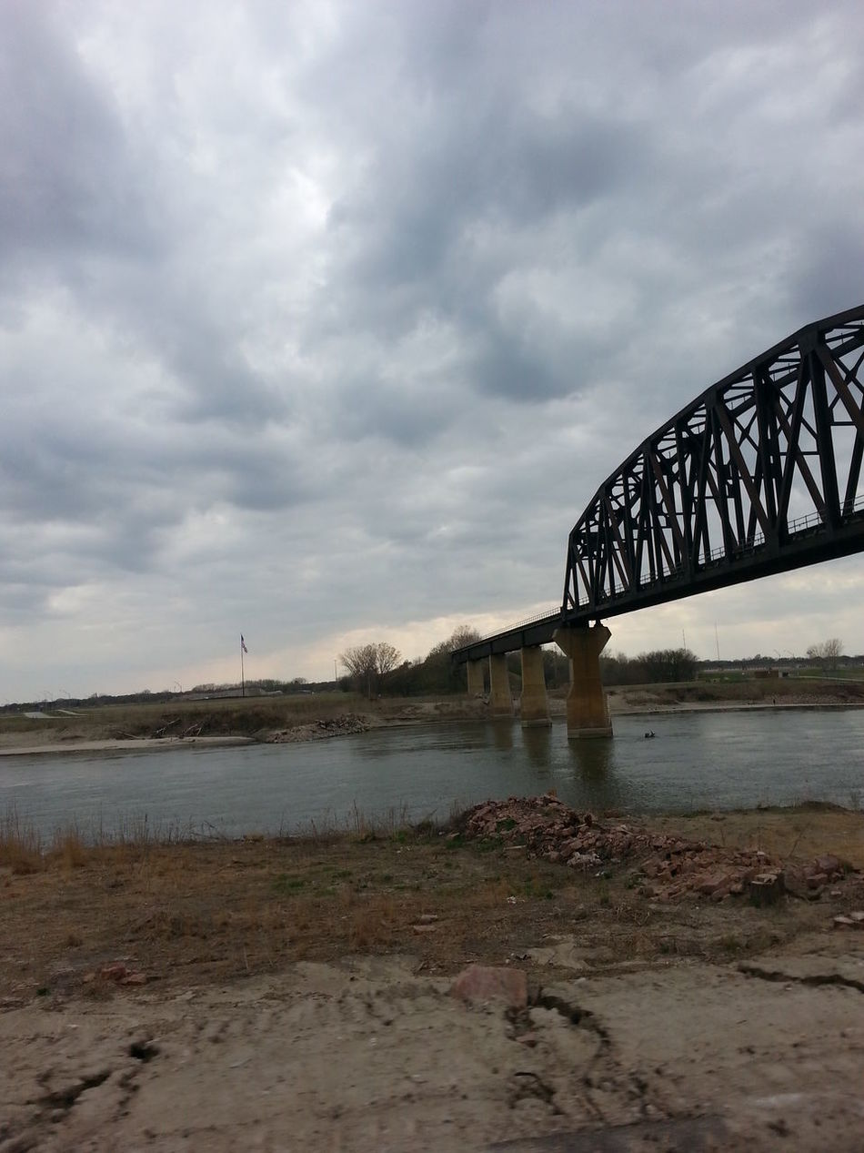Architecture Bridge Built Structure Cloud Cloud - Sky Cloudy Connection Distant Dusk Engineering Journey Low Angle View No People Onward Outdoors Overcast River Sky Structure Water Winter