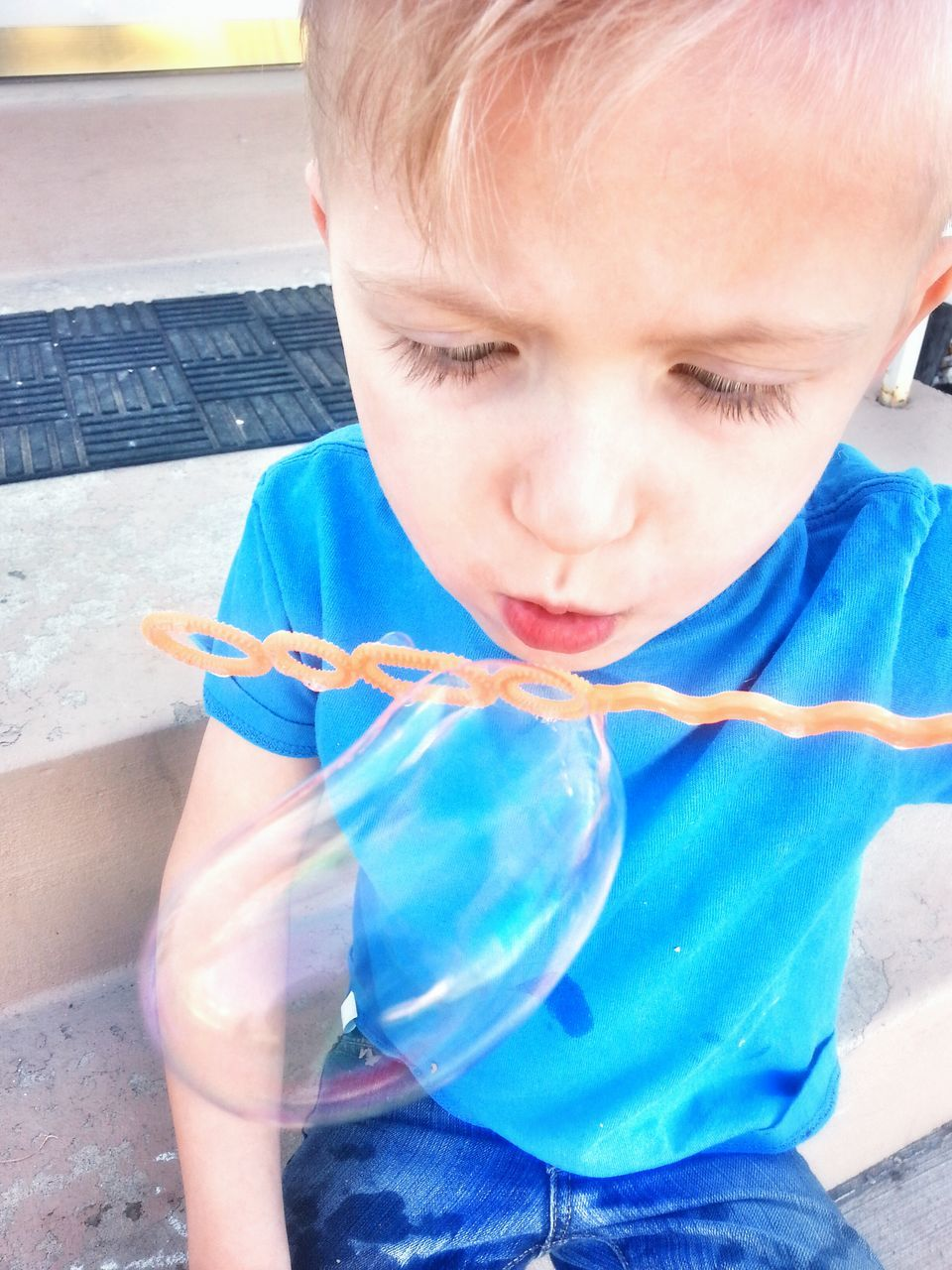 Close-Up Of Boy Blowing Bubble