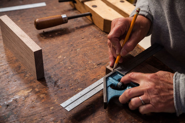 Craftsman Working Accuracy Carving - Craft Activity Craft Craftsmanship  Craftsperson Hand Tools Handmade Holding Instrument Maker Maker Manual Worker Occupation One Person Real People Skill  Tools Wood - Material Wood Shop Woodworking Work Tool Workbench Working Workshop