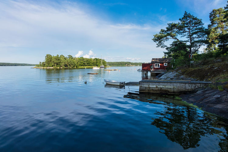 Archipelago on the Baltic Sea coast near Stockholm, Sweden. Archipelago Baltic Sea Boat Clouds And Sky Coast Cottage Day Holiday Journey Landing Stage Landscape Lidingö Nature Nature Outdoor Outdoors Shore Sky Sky And Clouds Sweden Tourism Travel Destinations Tree Vacation Water