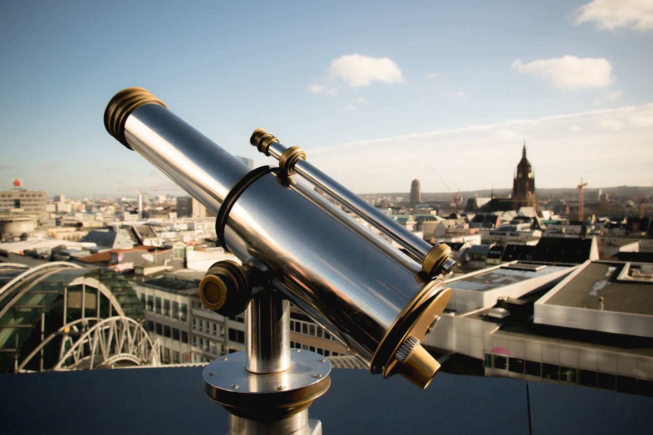 """On top of this viewpoint in Frankfurt (Germany), I admired this shiny vintage technology more than the """"standard view"""" on the city. Bestoftheday City View  Equipment Focus On Foreground From My Point Of View Germany Looking To The Other Side Metal Old-fashioned On Top Of The World Pipe - Tube Reflection Reflections See What I See Seeing The Sights Shine Shiny Technology Telescope View From Above Viewpoint Vintage Vintage Technology The Tourist"""