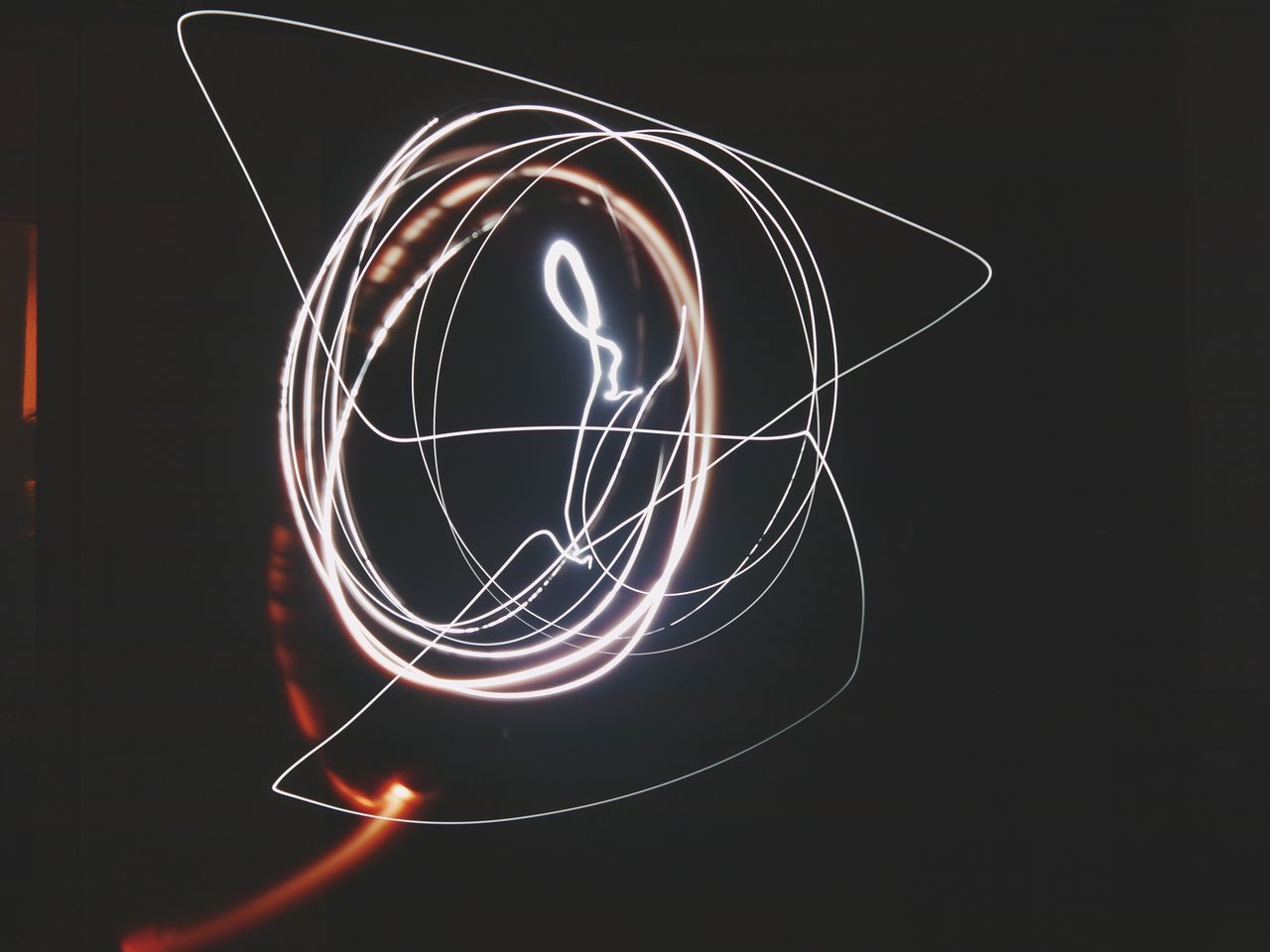 light painting, illuminated, long exposure, glowing, light trail, night, studio shot, black background, no people, lighting equipment, motion, swirl, close-up, indoors, electricity, wire wool