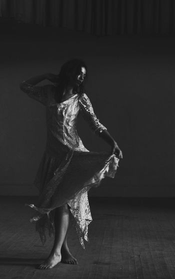 Adult One Woman Only Indoors  Full Length Shadow Abandoned Buildings Beautiful People Real People Dancing Bnw Black And White Photography Stage Theater Theater Curtain Lace Dress Shadows Natural Light Portrait Natural Light Haunted