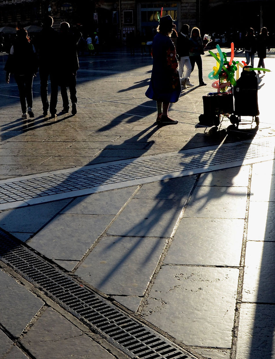 Adult Backlight Balloons City Clown Day Group Of People Leisure Activity Lifestyles Men Outdoors People Real People Shadow Silhouette Sunlight Urban Photography Walking Women