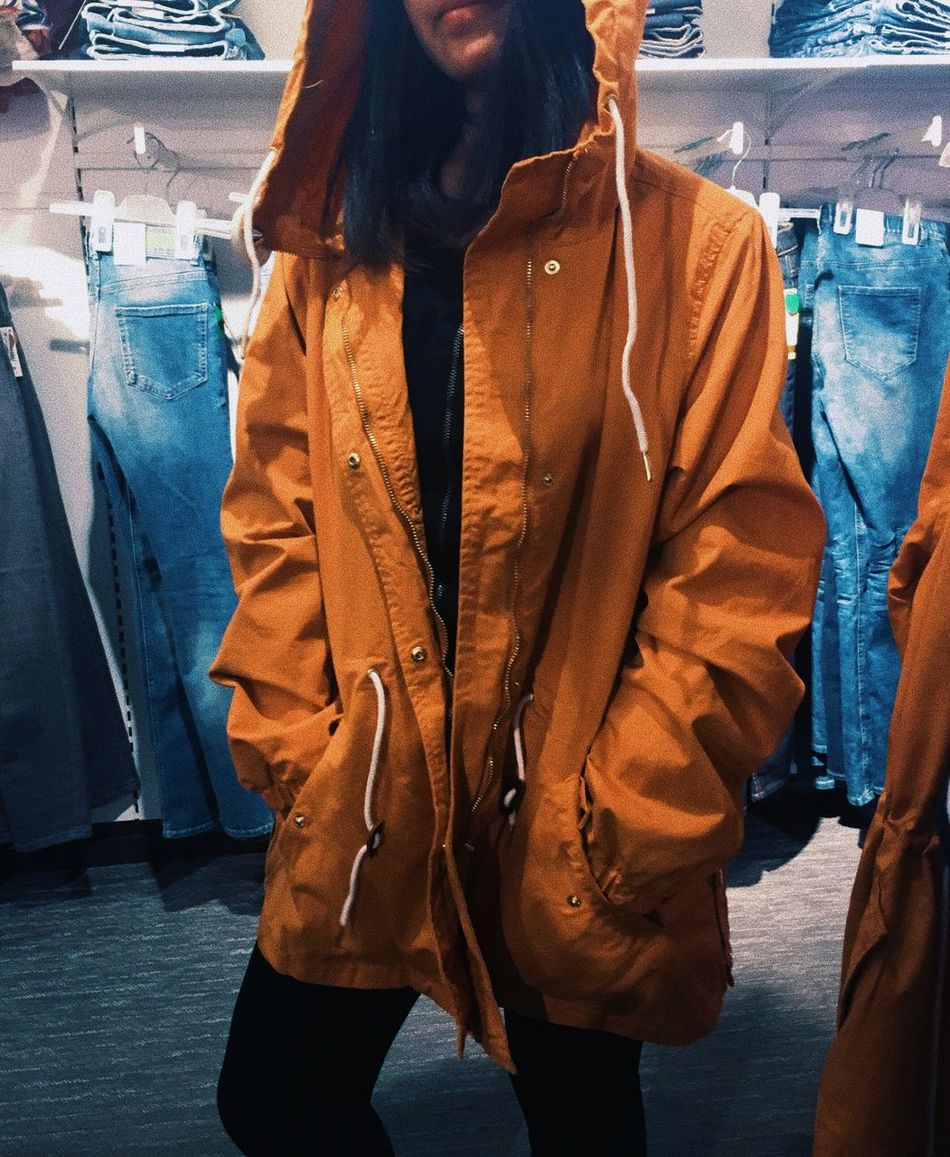 Retail  Jacket Clothing Jeans Casual Clothing Clothing Store Store Fashion Consumerism Lifestyles Real People Standing One Person Front View Customer  Leisure Activity Day Overcoat Indoors  Young Adult