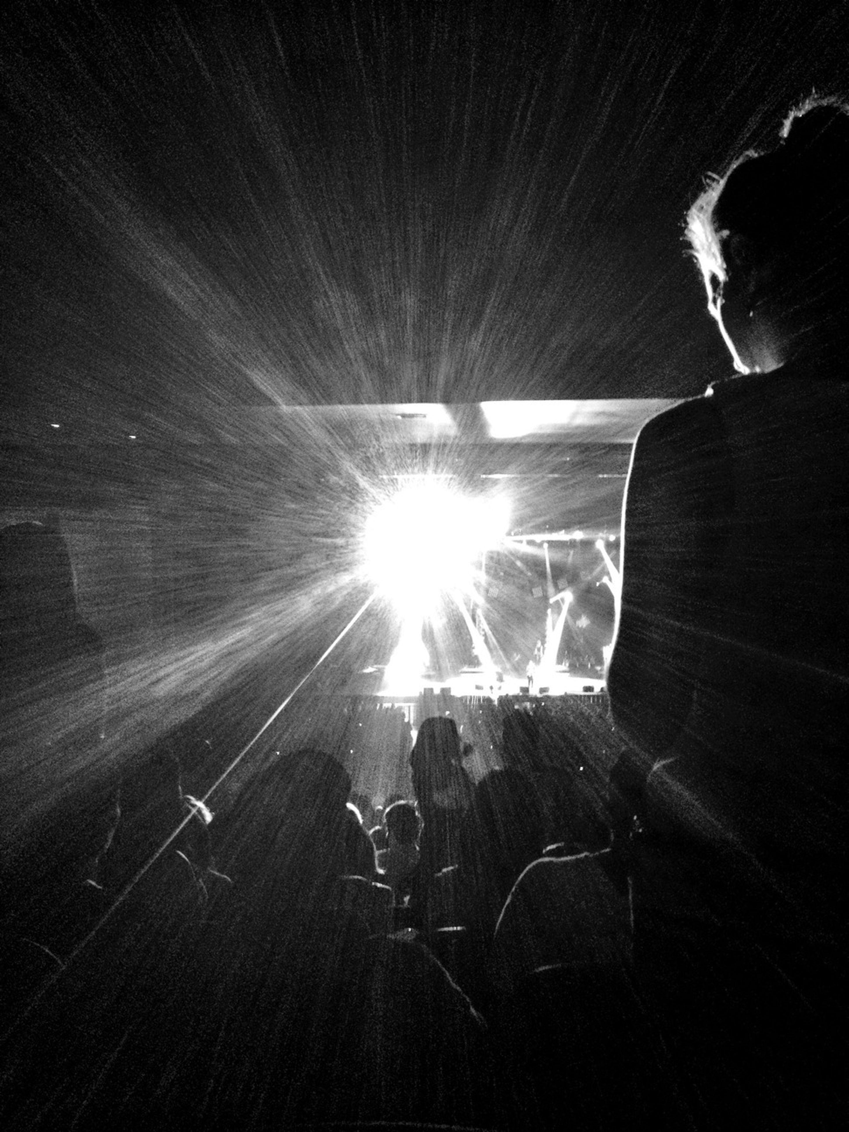 lifestyles, leisure activity, men, sunbeam, lens flare, sunlight, sun, silhouette, person, unrecognizable person, glowing, indoors, night, standing, light - natural phenomenon, dark