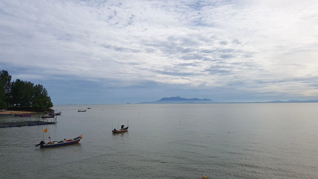 water, sky, nautical vessel, cloud - sky, transportation, scenics, nature, beauty in nature, mode of transport, tranquility, outdoors, sea, day, mountain, no people