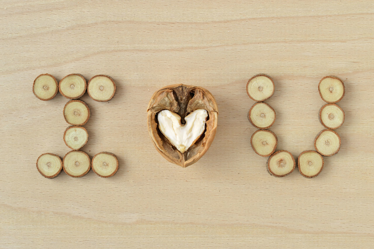 I love you Anniversary Authentic Authenticity Concept Craft Creative Heart I Love You Love Message Natural Nature Nut Relationship Romantic Rustic Simplicity Text Valentine's Day  Walnut Wood Wood Slices Word Writing Written