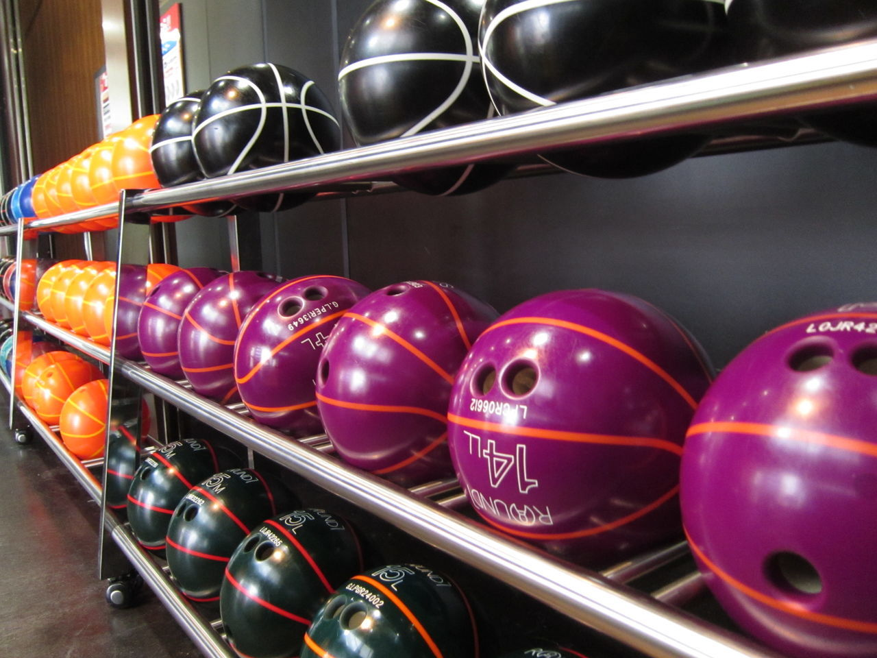 Bowling balls Balls Ballsport Bowling Bowling Alley Bowling Balls Close-up Hobbies Hobby Indoors  Multi Colored No People Rows Rows Of Things Shelf Sports