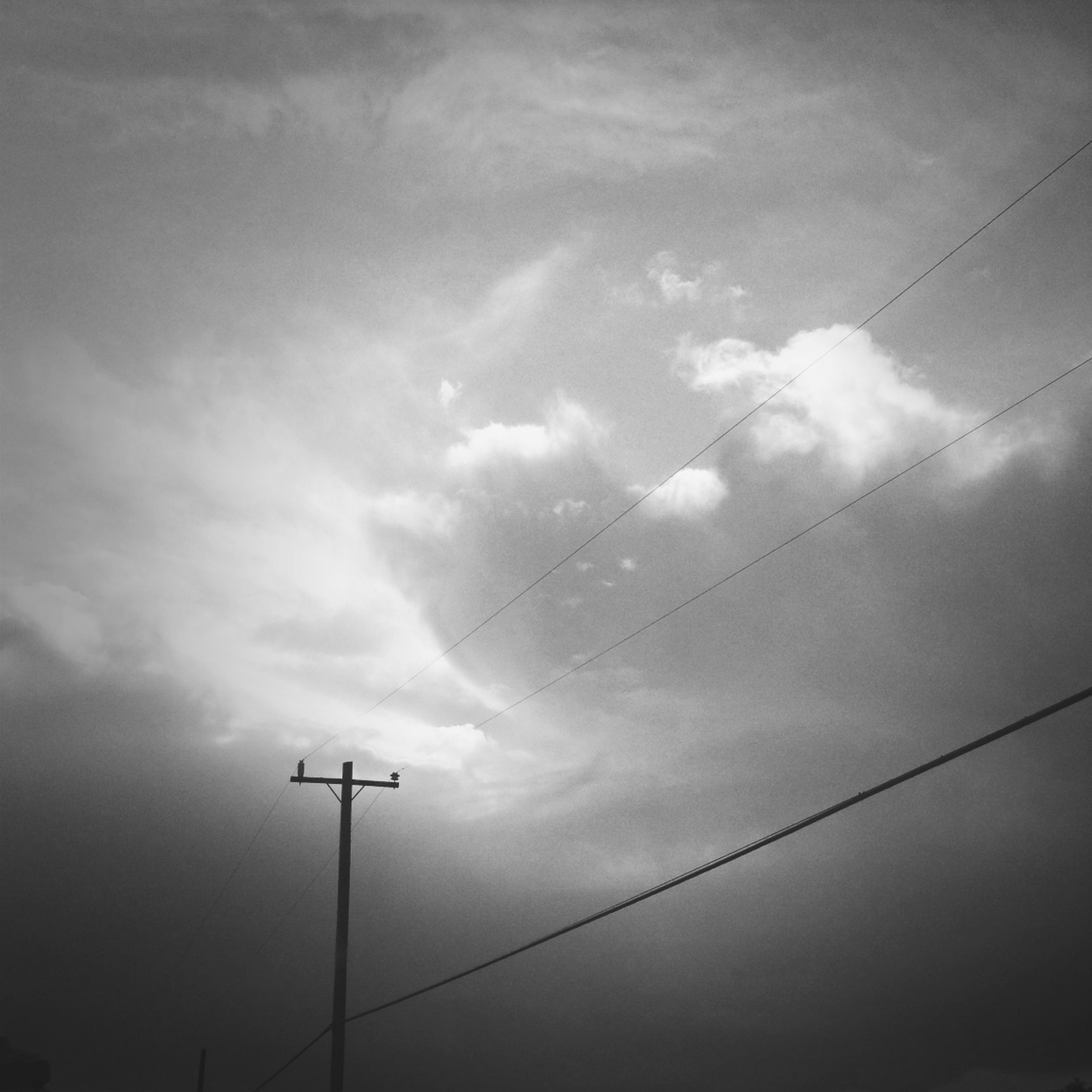 low angle view, sky, power line, electricity, cloud - sky, street light, technology, cable, power supply, fuel and power generation, electricity pylon, lighting equipment, connection, silhouette, cloudy, cloud, nature, pole, no people, outdoors