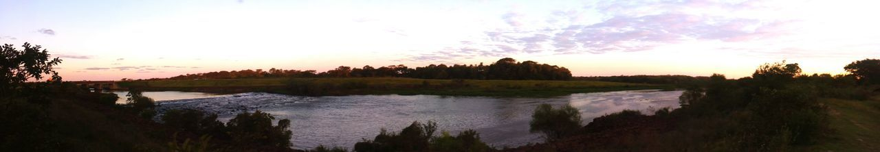river, sunset, tree, sky, water, nature, scenics, tranquil scene, beauty in nature, no people, tranquility, reflection, outdoors, travel destinations, panoramic, day