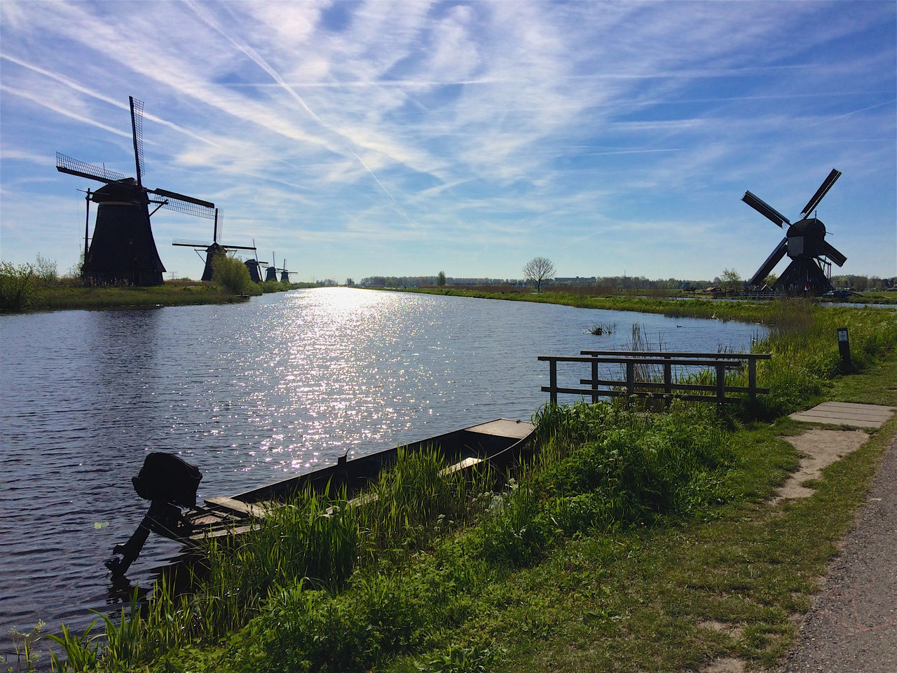 Windmills Kinderdijk Alternative Energy Architecture Beauty In Nature Boat Building Exterior Built Structure Day Environmental Conservation Kinderdijk Nature Netherlands No People Outdoors Renewable Energy Sky Water Water Reflections Wind Power Wind Turbine Windmill