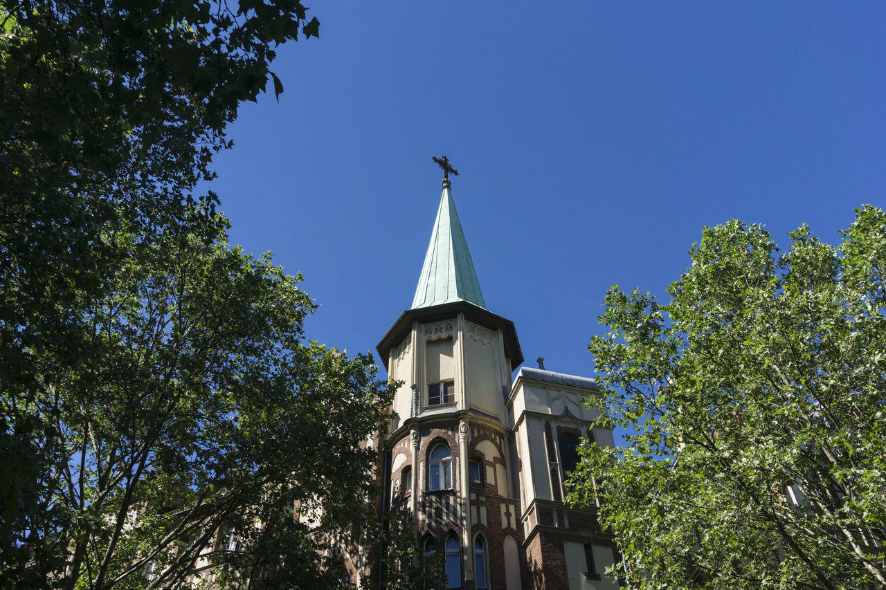 Tower of Methodist Church in Kreuzberg Architecture Berlin Blue Branch Building Exterior Built Structure Clear Sky Color Image Cross Day GERMANY🇩🇪DEUTSCHERLAND@ Horizontal Kreuzberg Low Angle View Methodist Church Nature No People Outdoors Place Of Worship Religion Sky Spirituality Tree