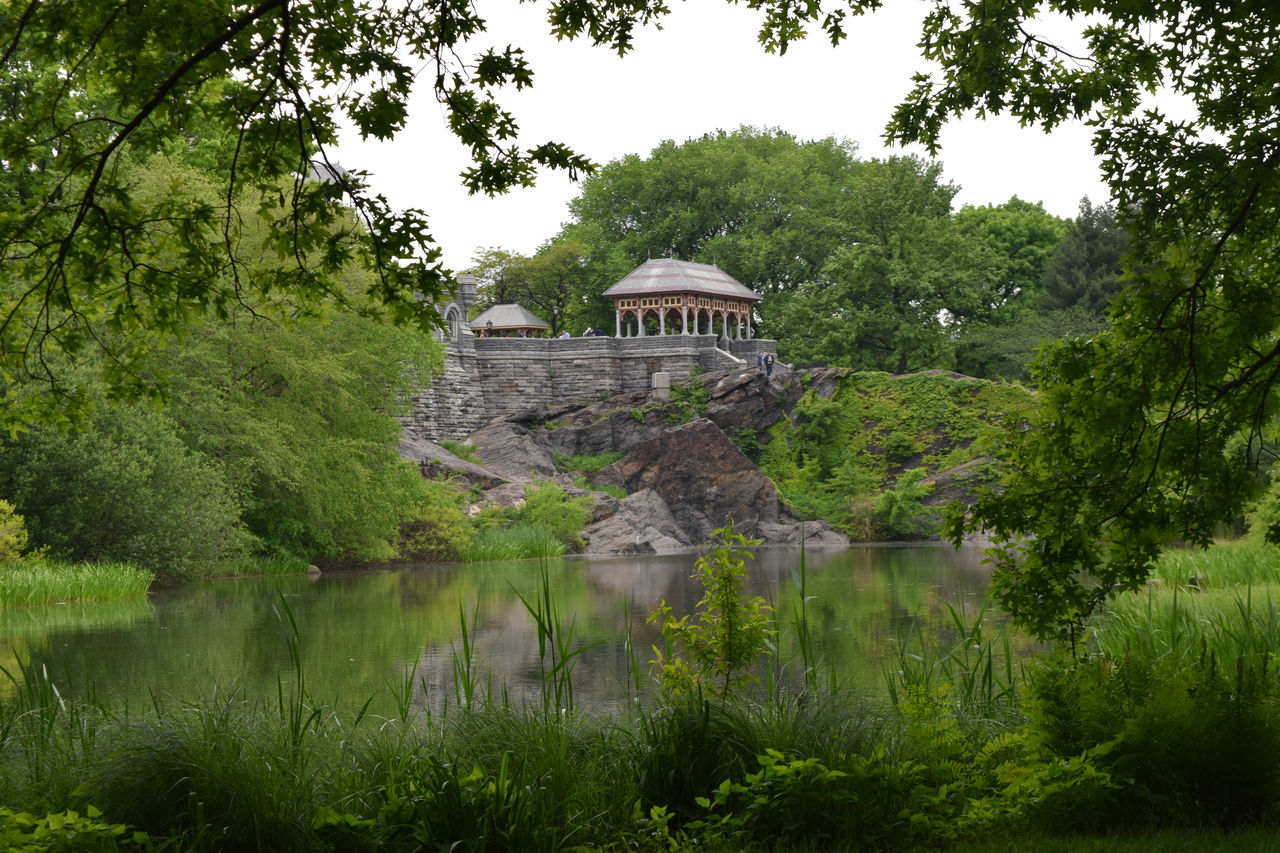 Gazebo On Rock Formation By Lake In Central Park