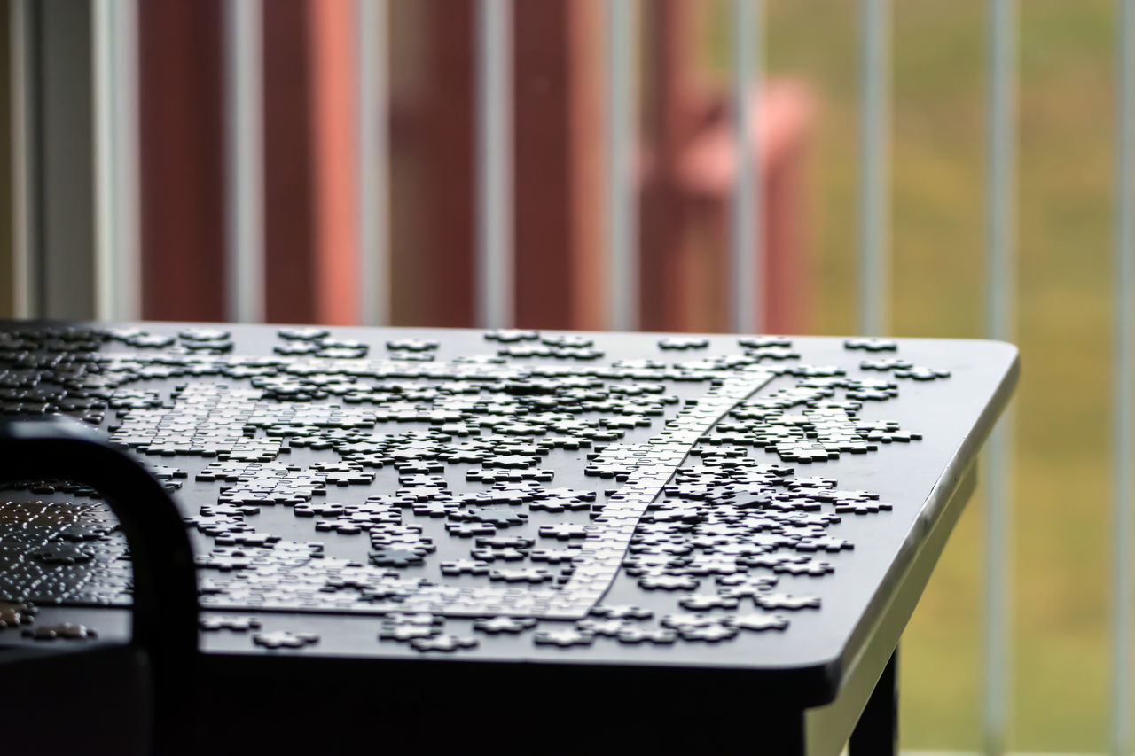 A puzzle Table Close-up Conceptual Conceptual Photography  Coordinate Coordination Day Fence Fun Hobby Hobbyphotography Indoors  Jigsaw Piece Jigsaw Puzzles Light No People Part Of Pattern, Texture, Shape And Form Pieces Puzzles Rails Relaxing Relaxing Moments Table Wood Working Together