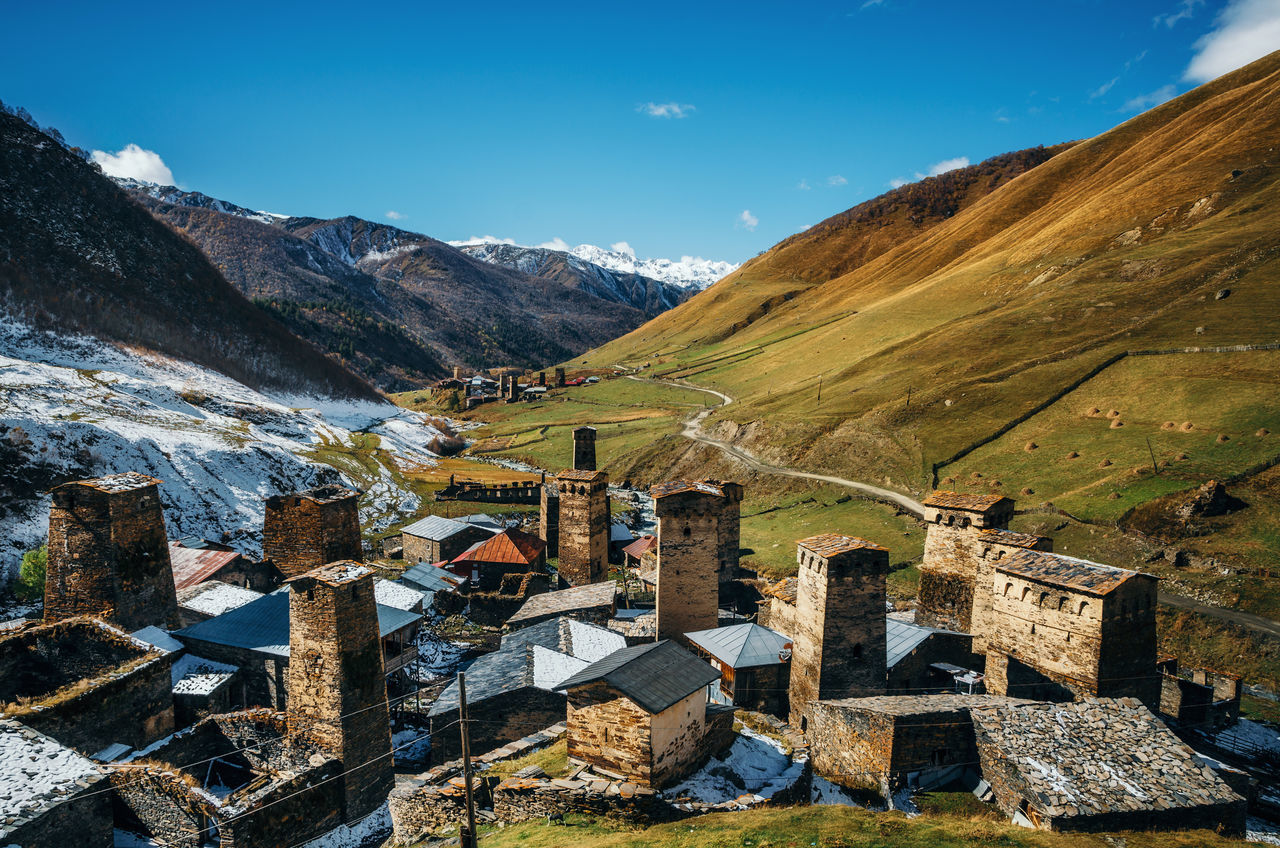 Svan Towers in Ushguli and Inguri river in autumn. One of the highest inhabited village in Europe. Caucasus, Upper Svaneti, Georgia. UNESCO World Heritage Site. View of Chajhashi and Murkmeli. Georgian landmarks Architectural Feature Architecture Architecture_collection Caucasian Georgia Landmark Landscape Medieval Mountain Outdoors Snow Stone Material Svaneti Towers Traditional Travel Destinations Traveling UNESCO World Heritage Site Ushguli Vacations View From Above