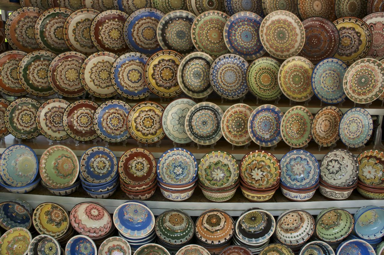 Bulgarian pottery Abundance Arrangement Baked Clay Bulgaria Bulgarian Choice Clay Collection For Sale Full Frame High Angle View In A Row Indoors  Large Group Of Objects Multi Colored Pottering Pottery Retail  Side By Side Variation