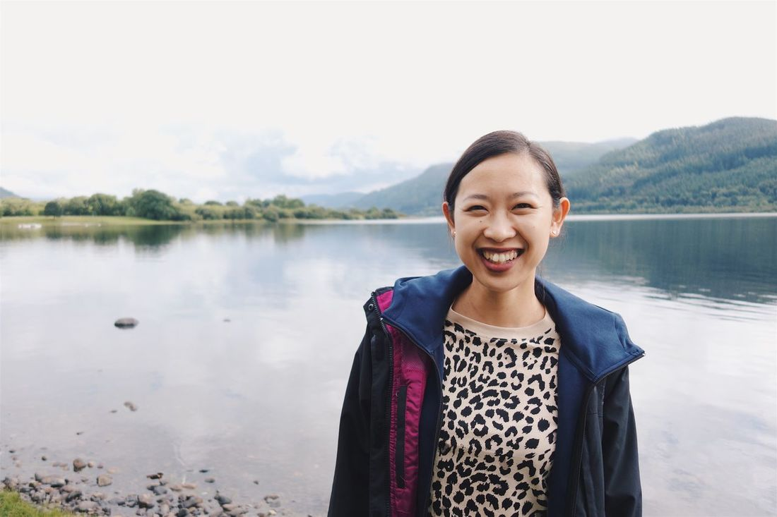 Happy panda Asian Ethnicity Lake Smiling Looking At Camera Portrait One Person Happiness Water Real People Lifestyles Front View Black Hair Young Adult Outdoors Standing Day Casual Clothing Nature Beautiful Woman Leisure Activity Bassenthwaite Lake