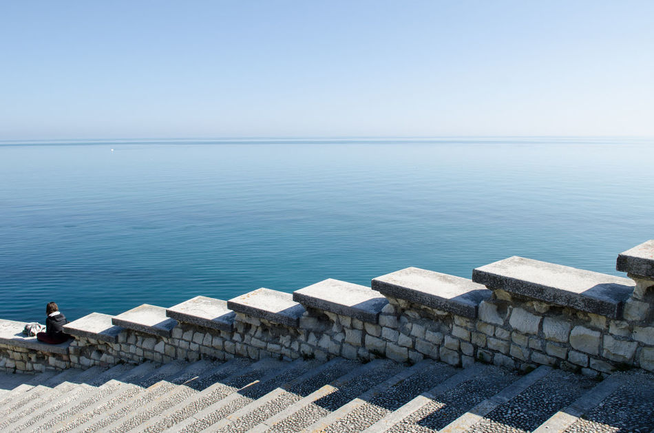 Beach Blue Blue Sky Calm Water Calmness Clear Sky Day Geometry Horizon Over Water Italy Lines Lonely Lonely People Nature Outdoors Sea Shadow Sitting Sitting Outside Sky Stairs Sunlight Thinking Water Waves